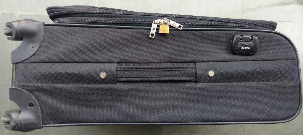 suitcase's built-in lock and external brass lock